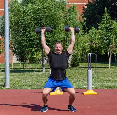 two arm dumbbell swings two arm dumbbell snatch total workout fitness