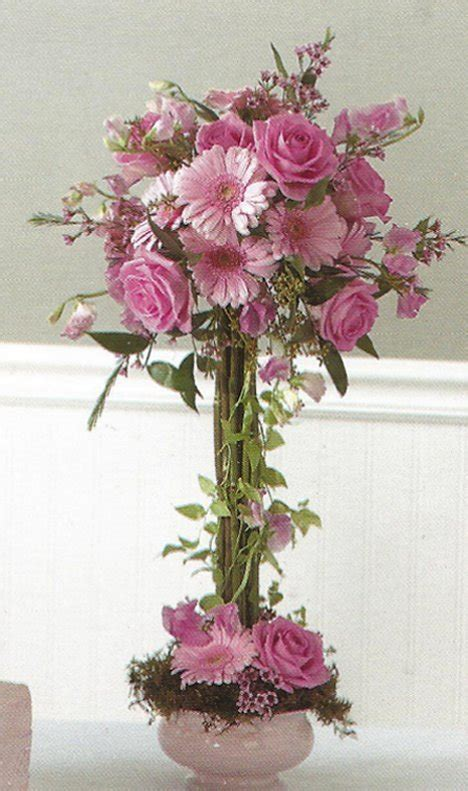 topiary tree centerpieces wedding flower centerpiece pink gerbera topiary