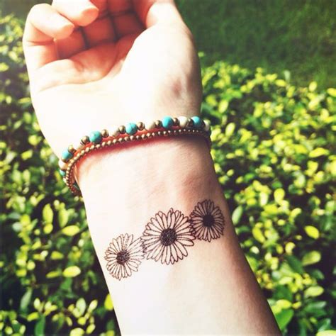 daisy chain wrist tattoo 1000 ideas about small on