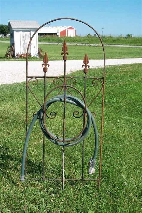 tall wrought iron trellis  hose winder