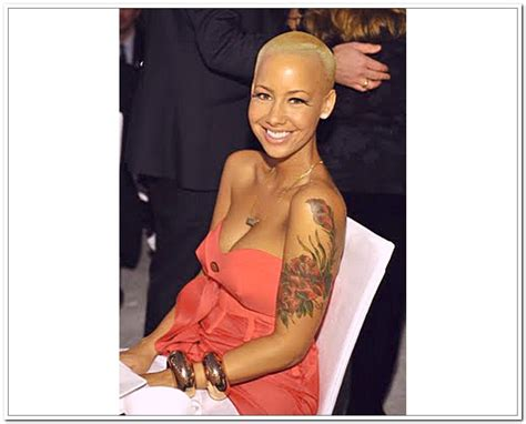 amber rose leg tattoo with flowers tattoos on left arm