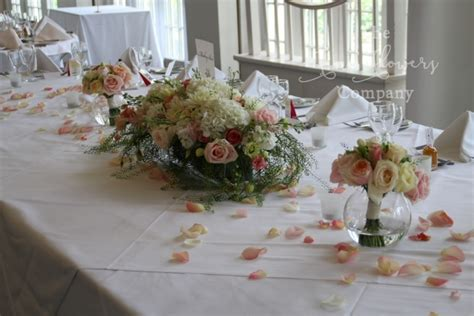 Beautiful wedding flowers at Monkey Island   garden ceremony