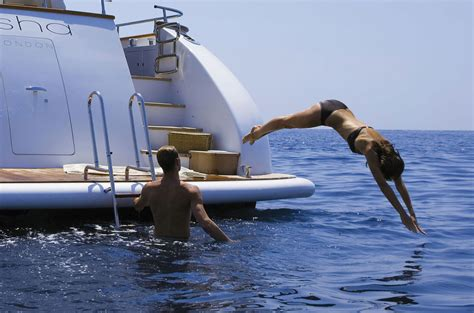 yacht girls girl diving off yacht superyachts news luxury yachts
