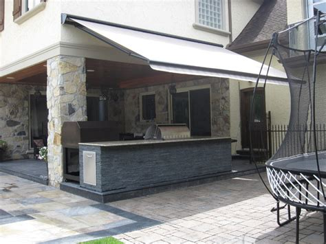 retractable awnings toronto retractable awning over outdoor kitchen contemporary patio toronto by rolltec