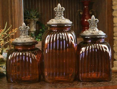 fleur de lis kitchen canisters set of three classy glass polystone fleur de lis decorative amber decorative glass canister set with fleur de lis lids