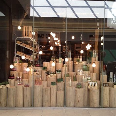 interesting outdoor decor pop up window display wood logs for display have them graduating all the way up