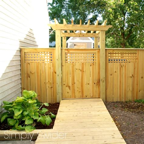 backyard fence gate a beautiful fence and gate with an arbor simply swider