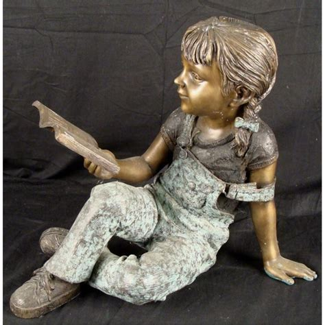 bronze child art sculpture  girl reading