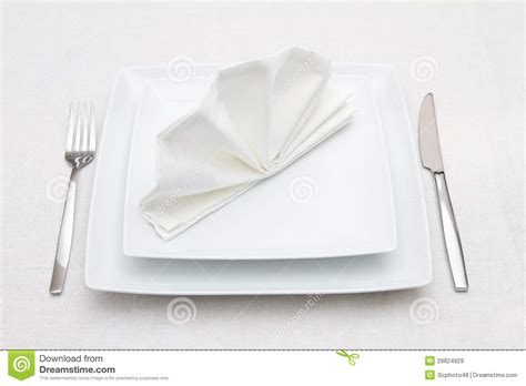 fancy place setting stock photo image of folded fancy place setting with white plates and white napkin royalty