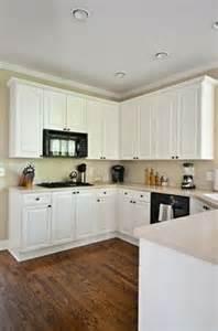 white kitchen cabinets on granite