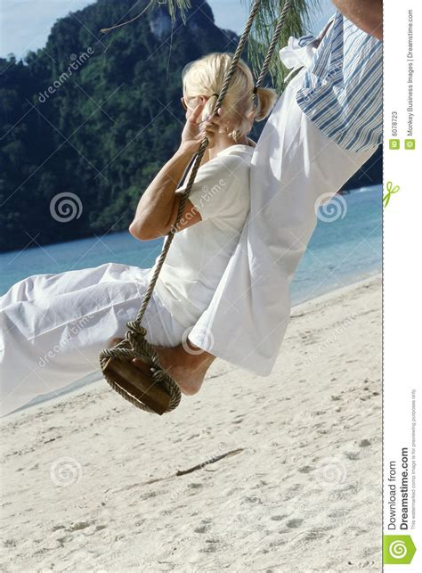 couple swinging video couple on swing at beach stock photos image 6078723