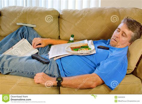 a man and a couch busy sleeping man couch potato stock image image 25003033