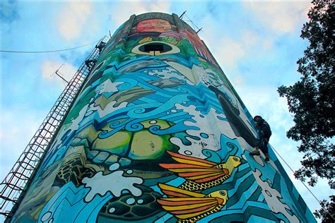 artists turn water tank into art piece in isabela photos