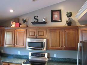 decorating ideas for top of kitchen cabinets pictures of decorating ideas above kitchen cabinets home