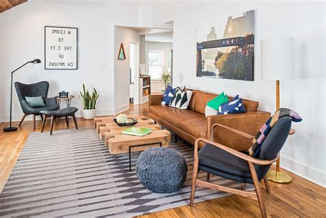 Amazing Blue Leather Sofa Living Room #1: Austin-navy-blue-chairs-with-solid-color-sofas2-living-room-midcentury-and-brown-leather-sofa-knit-pouf.jpg