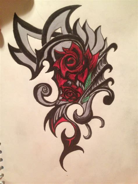 tribal dragon and red rose tattoo on side real photo