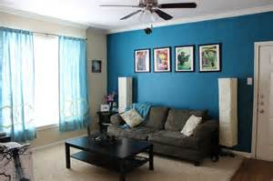 teal color room i like this blue color maybe the tv and wall