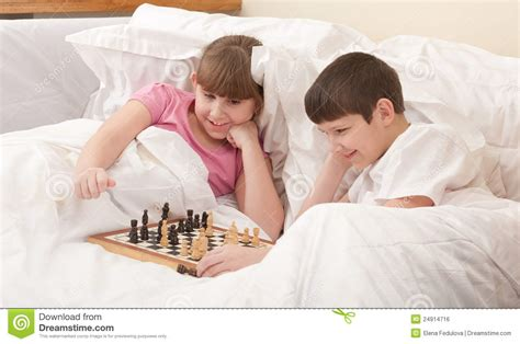 how to roleplay in bed children play chess in a bed royalty free stock image