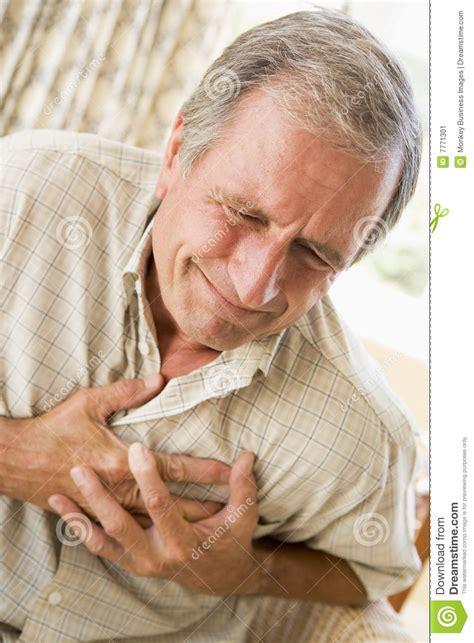 imagenes de corazones saliendo del pecho man clutching his heart stock image image of caucasian