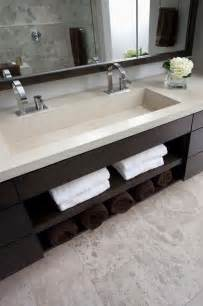 storage bathroom sink restroom cabinets contemporary the sink is integrated into one long piece of concrete and has his and