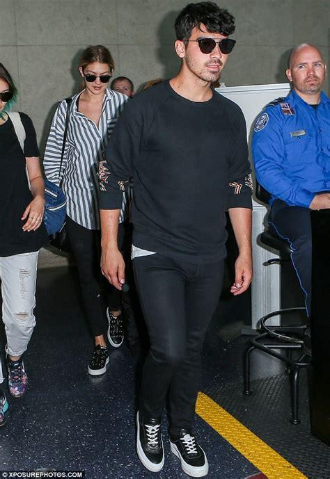 Jo In Shirt White Intl gigi hadid may be wearing joe jonas s shirt during flight