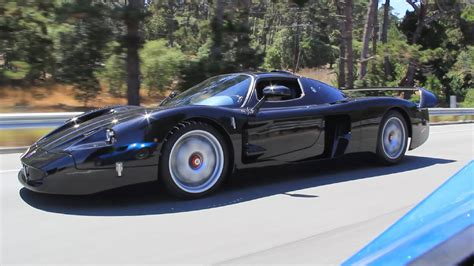 maserati road 1 1 black maserati mc12 on the road