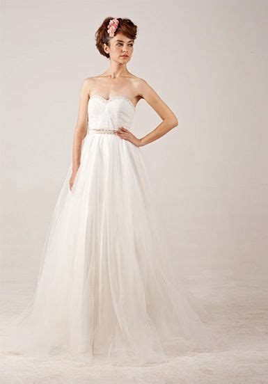 Dress White Tulle Flow i like the flow and the beading aspects of this gown form fitting beautiful