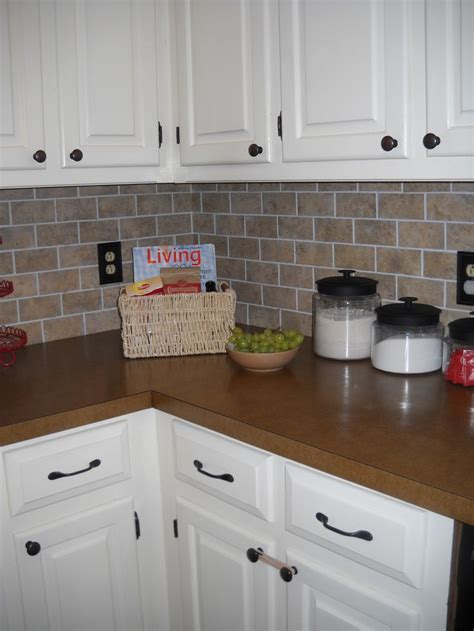vinyl kitchen backsplash our diy brick backsplash using vinyl floor tiles cut into mini quot bricks quot total cost 20