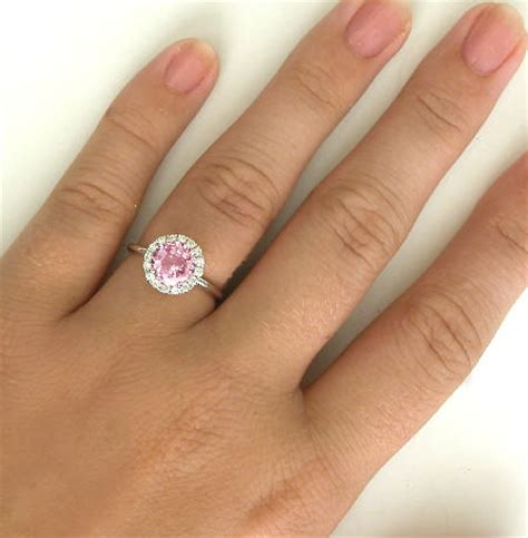 light pink sapphire engagement rings natural round peachy pink sapphire and halo