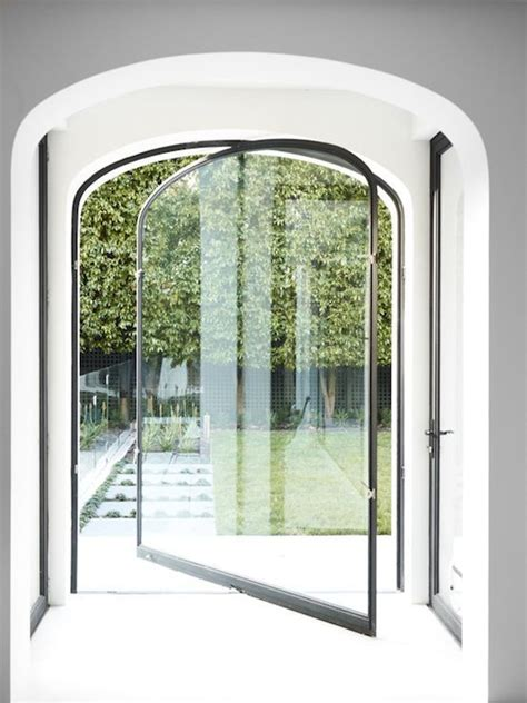 Seamless Glass Doors 15 Bold And Modern Pivot Doors To Get Inspired Shelterness