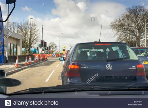 traffic jam of cars queuing at traffic lights with road