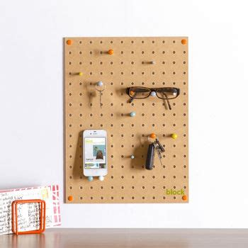 white pegboard with wooden pegs small by block design pegboard with wooden pegs small by block