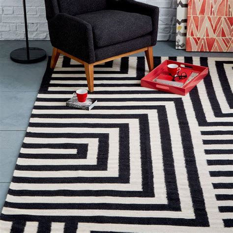 black and white rug create drama with black carpets and rugs