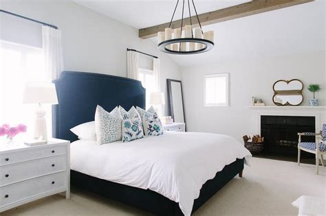 white and navy bedroom with fireplace contemporary