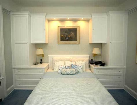 custom white built  wall unit  bed