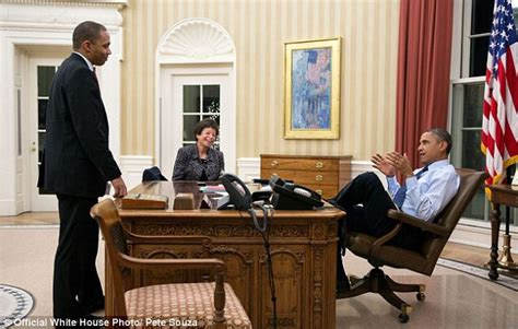 obama resolute desk obama photo showing president with foot on oval office s