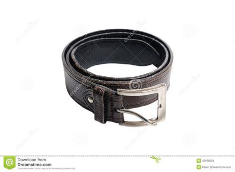 single used black leather belt on white background stock