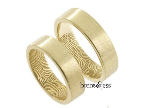 set of 14k yellow gold fingerprint wedding bands with