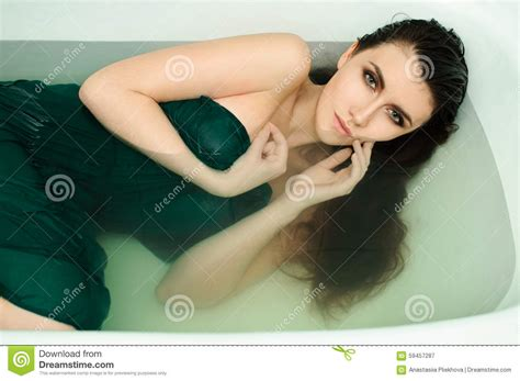 sexy bathtub beautiful young girl with dark hair wet stock image