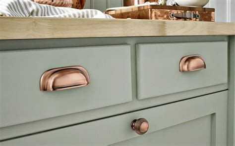 white kitchen cabinets with copper cup pulls and copper sink transitional kitchen 76 best images about copper hardware on pinterest