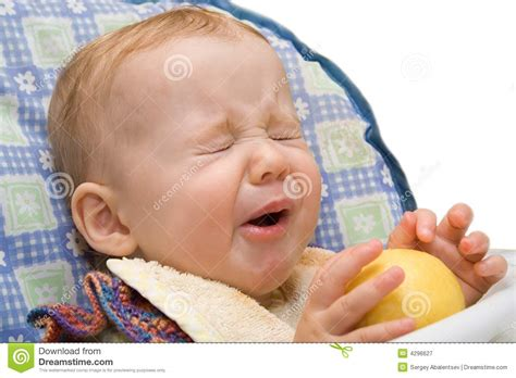 eats lemon baby lemon on isolated background royalty free stock photography image 4296627