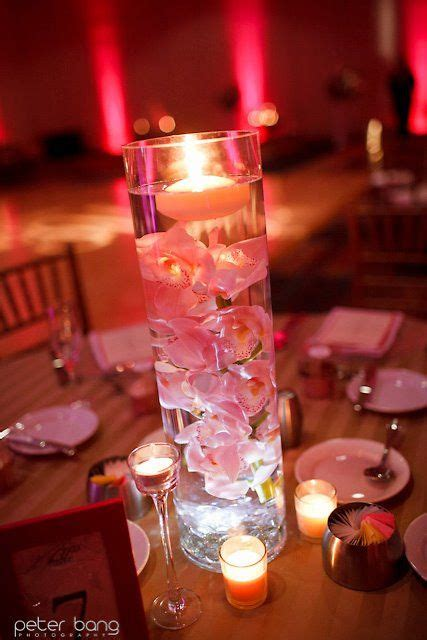Cylinder Vases With Floating Candles And Flowers by Cymbidium Orchids Submerged In Cylinder Vases Topped