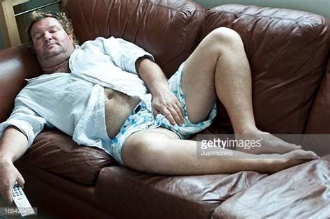 bbw on couch fat guy lying down stock photos and pictures getty images