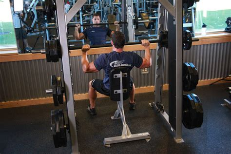 will smith bench press smith machine overhead shoulder press exercise guide and video
