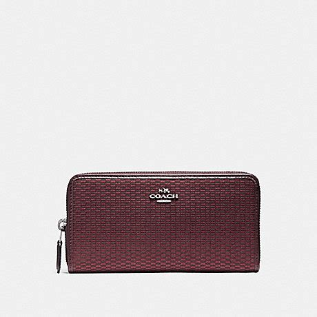 Coach Accordion Zip Wallet F13677 coach f13677 accordion zip wallet in legacy jacquard black antique nickel oxblood 1 coach