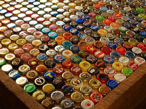 how to make a bottle cap bar top bottle cap table or bar top i saw a bar top like this