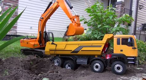 Mainan Mobil Tumbling Tip Lorry rc excavators at work will take you to a happy place
