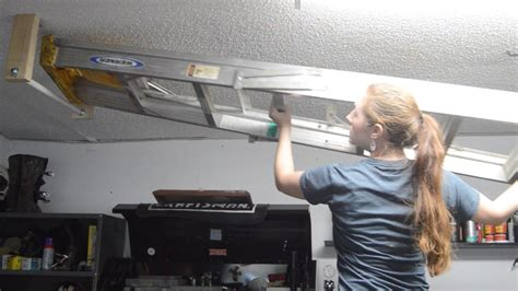 how to hang a l from the ceiling how to hang a ladder from the ceiling youtube extension