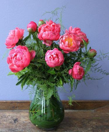 a vase of beautiful peony roses