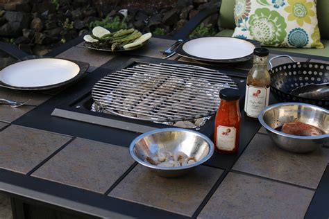 pit cooking table propane pit table becomes a charcoal grilling table